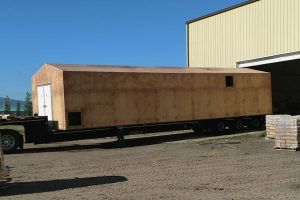 12'X45' LOADED AND HEADING TO TEXAS. THIS CUSTOMER PAINTS THE BUILDING AND SKID AFTER INSTALL SO WE SHIP IT BARE